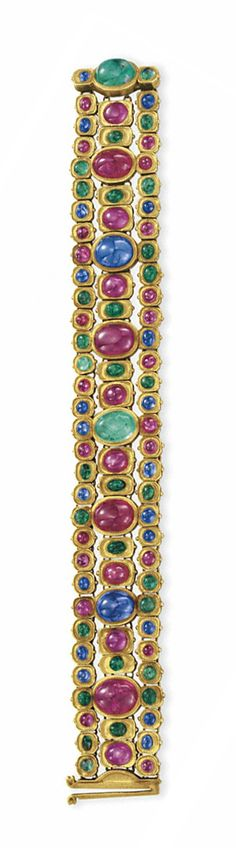 A RUBY, SAPPHIRE, EMERALD AND GOLD BRACELET, BY TIFFANY & CO.   Designed as a series of bezel-set cabochon rubies, sapphires and emeralds, to the flexible three-row band designed as a series of smaller cabochon rubies, sapphires and emeralds, mounted in gold, circa 1915, 7¼ ins.  Signed Tiffany & Co., no. 4199, possibly by Louis Comfort Tiffany