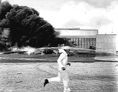 A sailor runs for cover past flaming wreckage hit by dive bombers that had already blasted Pearl Harbor and Hickam Field; Pearl Harbor Day, Pearl Harbor Attack, Remember Pearl Harbor, Uss Arizona Memorial, Battleship, Us Navy, Oahu, Historical Photos, 1940s