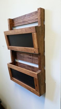 DIY Reclaimed wooden wall file with chalkboard inserts.