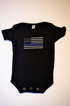 A personal favorite from my Etsy shop https://www.etsy.com/listing/265917801/thin-blue-or-red-line-onesietshirt