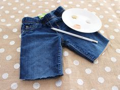 Upcycle worn kids' jeans with scissors and craft paint. Hint: a pencil eraser prints great polka dots! >> http://blog.diynetwork.com/maderemade/2013/08/05/trash-into-treasure-toddler-clothes?soc=pinterest