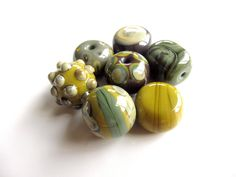 Cool Lampwork Glass Beads! by theorangebell on Esty
