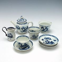 A Lowestoft Porcelain Garden Pattern Toy Tea Set c1764   Toy tea set containing four teabowls and saucers, a teapot and cover, milk jug and sucrier Teapot Size : 8.4cm tall by 10.8cm in diameter Jug Size : 5.8cm tall by 5.9cm in diameter Sucrier Size : 4.6cm tall by 6.7cm in diameter Teabowl and Saucer Size : 3.6cm tall by 7.5cm in diameter Condition : The teapot handle has been broken and re-attatched,  underglaze chip on the footstring. The sucrier is missing its cover and ther £6,200