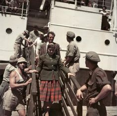 #Capa in Color  1949 •  New immigrants disembarking from the Theodor Herz, near Haifa, Israel http://www.theguardian.com/artanddesign/2013/dec/14/robert-capa-colour-exhibition-new-york …