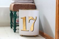 an old trashcan with an updated DIY gold number paint job. Cute  Functional: 5 DIY Projects That Look Good  Make Life Better