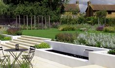 Barn Conversion Contemporary Family #Garden. By London garden designer Cassandra Crouch. This large garden in Hertfordshire sits to the rear of a modern barn conversion owned by a young family.