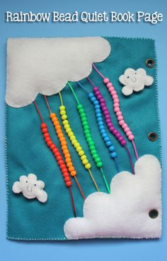 TheInspiredHome.org // Quiet Book Pages: Rainbow Bead Page Tutorial. A felt quiet book page including puffy clouds and strands of bright, co...