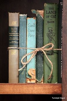 Tie a piece of string around books to keep them together and add a rustic feel to your bookshelf. -LendingTree