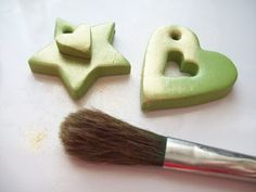 The polymer clay is brushed with Pearl Ex powder