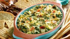 Filled with hearty, leafy spinach, artichoke hearts and savory Monterey Jack cheese, this tasty hot spinach & artichoke dip recipe never disappoints.