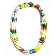 """Strands of beads tied with two coated hemp knots resembling stones. Can be worn knots at back or at side. Slips over head. 25"""" around. Shipped with logo-stamped drawstring bag."""