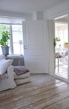 Airy interior with a white background and distressed wood flooring