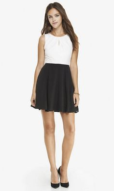 Express: This is a dress for the holidays for the classy/ sophisticated girl! This is a sleeveless white/ black dress with a small keyhole. Sale Price: $39.95, Original Price: $79