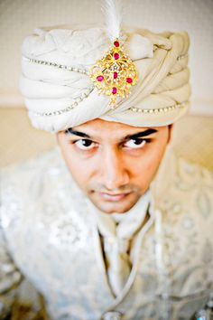 Indian groom with white turban and jewel on IndianWeddingSite.com