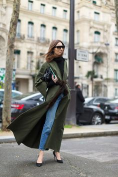 Try the minimalist look this spring with blue skinny jeans, classic black pumps and a long duster jacket—like this one in olive green for that military-inspired look. See more spring outfit ideas here: