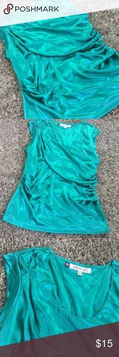 Jennifer Lopez beautiful emerald sleeveless top It's as comfortable as it looks! Emerald green sleeveless top with capped sleeves. Gathered in torso area, as pictured. Excellent condition! Bundle for further discounts! Jennifer Lopez Tops Tunics