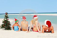 christmas pictures on the beach ideas family | Royalty Free Stock Image: Family Sitting On Beach With Christmas Tree ...