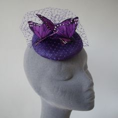 Purple Butterfly Fascinator with Veiling and Feather Butterflies in Large £37.50