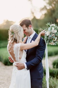 Anna Campbell Bride Lisa wearing the Coco Silk Tulle Dress   Vintage inspired low back detail with bow   Hand embellished with sparkling beading and lace detail   Bohemian boho and romantic wedding dress