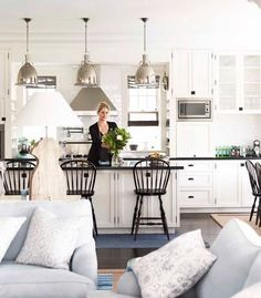 Love the sofa cushion colour; blends oddly well with b kitchen. Like the rangehood and stools. | Kitchens