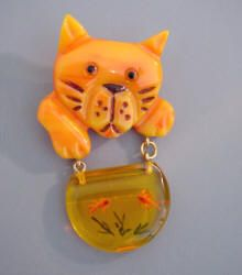 An adorable vintage Shultz Bakelite Cat and Fish Bowl Dangle Brooch.  Cute.