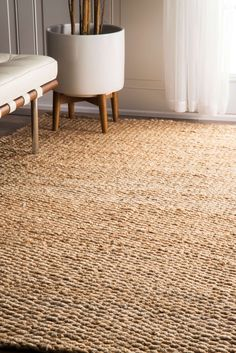 Bring the rustic and natural look to your space with this natural shade jute rug. It is handspun, soft and durable with 100 percent natural jute fiber, and ribbed construction that adds texture and dimension to any indoor setting.