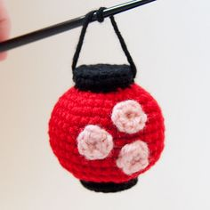 """These little amigurumi lanterns are based on the paper lanterns seen so often in Japan. The round red lantern is decorated with three cherry blossoms and the tall white lantern features the kanji character for """"strength. Crochet Lamp, Crochet Eyes, Diy Crochet, Crochet Crafts, Yarn Crafts, Crochet Projects, Octopus Crochet Pattern, Crochet Dolls Free Patterns, Amigurumi For Beginners"""
