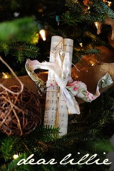 rolled-up music sheets tied with ribbon