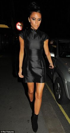 Who made Victoria Beckham's grasy dress and black suede boots? Shoes – Christian Louboutin Ariella Talon Suede Ankle Boots  Dress – Victoria Beckham Collection Briseux Silk Mini Dress in Black