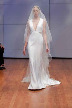 """Rebekka"" deep V-neck gown by RIVINI   NY Bridal Week. Photo: Courtesy of RIVINI by Rita Vinieris. Read More: http://www.insideweddings.com/news/fashion/see-the-rivini-by-rita-vinieris-fallwinter-2016-collection/2512/"