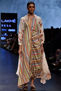 Featuring an off white trench dress in cotton base with multi colored floral prints. Designer Wear, Designer Dresses, Neeta Lulla, Trench Dress, Celebrity Closets, Indian Fashion Designers, Pernia Pop Up Shop, Draped Dress, Indian Outfits