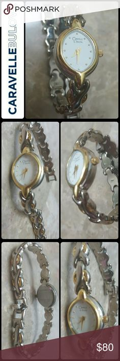 Caravelle by Bulova Two-Tone Watch Bulova Signature Watch in Caravelle Style,  Two-Tone Bulova Quartz in Base Metal Bezel,  Stainless Steel Back,  Japan Movement, Used in Good Condition, Needs New Battery! About 7 inches Length Bulova Accessories Watches