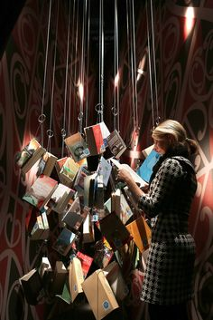 A visitor look at hanging books at the New Zealand stand at the Frankfurt Book Fair on October 2012 in Frankfurt, Germany. The Frankfurt Book Fair is the largest in the world and will run from October 10 -