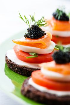 Salmon, mozzarella, tomato, cream cheese, scallion and a sprinkle of your favorite caviar on pumpernickel. Garnish with dill! Elegant & fabulous!