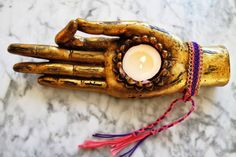 Hand of Buddha candle holder