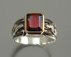GUARDIAN ANGELS silver and 14K ring with emerald cut Garnet. $490.00, via Etsy.