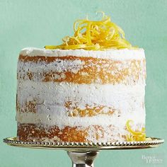 """Satisfy your sweet tooth with this yummy lemon cake! The """"naked cake"""" is topped with finely shredded lemon peel. This refreshing dessert is quick and easy to make."""