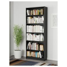 IKEA - HEMNES, Bookcase, black-brown, Solid wood has a natural feel. The shelves are adjustable so you can customize your storage as needed. You can hide multiple power strips, etc under the removable bottom shelf. Ikea Hemnes Bookcase, Ikea Billy Bookcase, Black Bookshelf, Bookshelves, Billy Regal, Closet Shelves, Wood Veneer, Adjustable Shelving, Storage Solutions