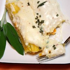 Pumpkin Manicotti with Bechamel Sauce- once of our very favorite fall recipes.  Can be made with butternut squash too!