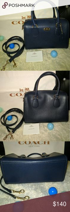 NWOT Authentic Coach cross grain mini Bennett Genuine Coach mini Bennett satchel in midnight cross grain leather.Gold hardware.Detatchable,adjustable crossbody strap. Zipper pocket inside with lesser pocket opposite. Fabric lining. Used only for photoshoot,flawless and new without tags. On trend mini size and worry free treated leather wipes easily no matter what . Wear cross body for casual look or arm handles for more sophisticated look. Matches every outfit Coach Bags Mini Bags