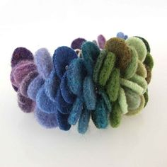 I just created this fabulous cuff bracelet using recycled sweater felt. The colors range from deep purple through various blues to a soft gr. Felt Bracelet, Felt Necklace, Textile Jewelry, Fabric Jewelry, Fabric Yarn, Fabric Crafts, Felt Crafts Patterns, Felt Diy, Felt Flowers