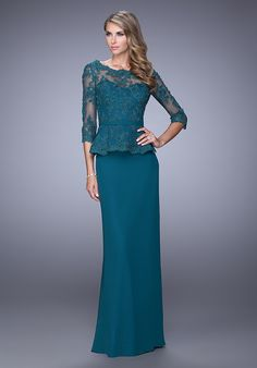 Elegant crepe chiffon dress with sheer 3/4 length sleeves. The bodice is sheer lace with a peplum and belt at the waist. Back zipper closure. Evening Collection Size Chart B.