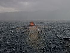 Swimming in the Rain! TJ, Me, Family <3    (Photo and caption by Camila Massu Winner 2012 National Geographic Travel)