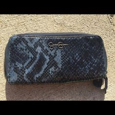 Wallet Jessica Simpson wallet, black and blue, two sides, used twice.  In excellent condition. Jessica Simpson Bags Wallets