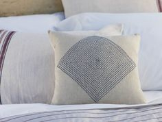 I could sew french knots like this lovely pillow from Coyuchi.