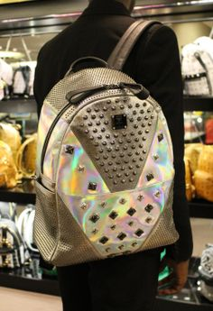 It's 'back to the future' with this fashion forward #MCM's holographic backpack. #HarrodsExclusive