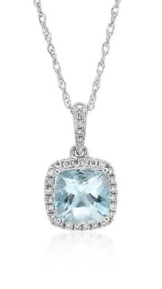 Flaunt some sophistication with this cushion-cut aquamarine gemstone pendant framed with a halo of brilliant diamonds in 14k white gold.