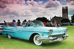 58 Caddy baby blue convertible.  My Pop had one.  (slightly used at the time;-)