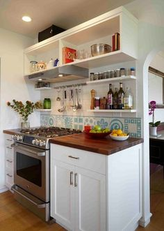 transitional kitchen by Kahn Design Associates - like open shelves above stove - do on wall between windows
