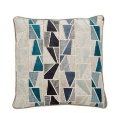 This decorative pillow, has a detailed geometric design, with shapes in colors of; navy, sky blue, and turquoise. Size: x Taupe velvet Pipe Feather Down Made in the USA